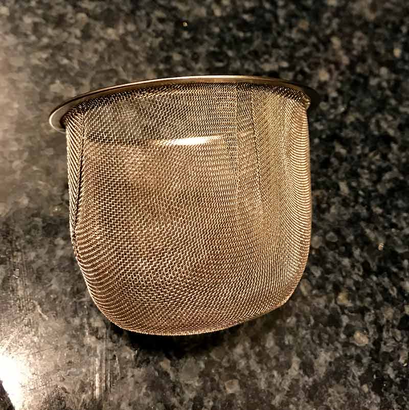 Stainless steel mesh tea strainer used for decanting wine